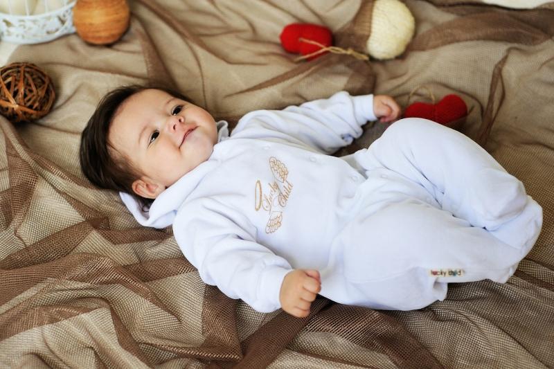 Как выбирать одежду для новорожденного ребенка.